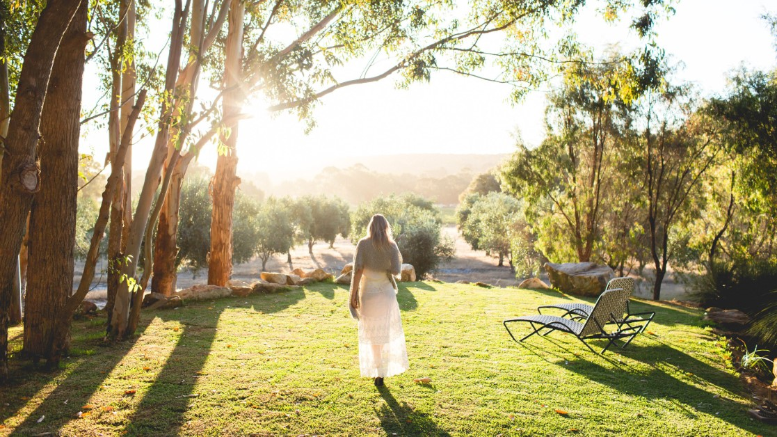 The sunlit grounds of Empire Retreat, Yallingup