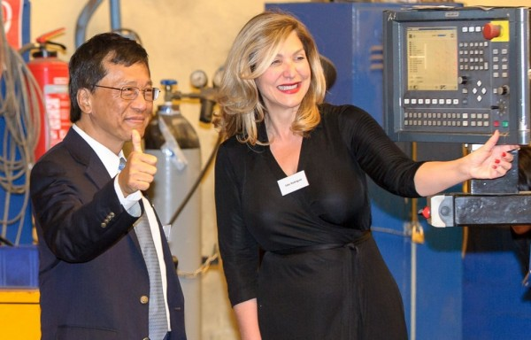 Genting Hong Kong Chairman and CEO Tan Sri Lim Kok Thay (left) and Edie Rodriguez, President and CEO of Crystal (right) at the Steel Cutting Ceremony for Crystal River Yachts