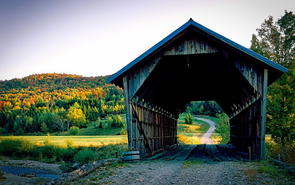 A covered bridge and fall foliage in Vermont